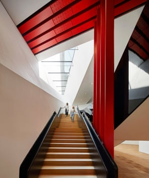 Dynamic descent … the staircase wraps around red steel beams.