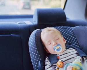 Baby boy (6-9 months) sleeping in car seat