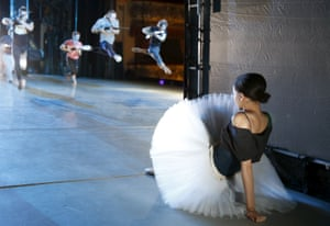 Dancer watches rehearsal