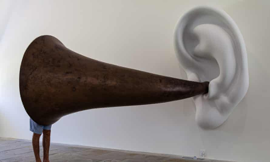 A gallery visitor inspects Beethoven's Trumpet (with Ear), 2007, by John Baldessari.