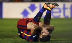 Barcelona's Luis Suarez is disappointed with himself after his penalty miss.