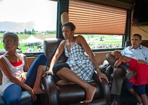 The family sit on a campaign bus watching television. They had got together to celebrate Malia's 10th birthday.