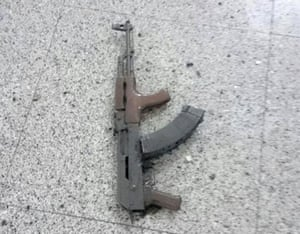 A Kalashnikov is seen on the floor of Ataturk Airport.