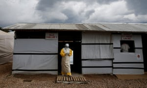 A health worker in protective clothing leaves the dressing room at the Ebola treatment centre in Beni, in the Democratic Republic of the Congo