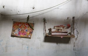 A picture of a Hindu deity and the holy book Ramayana are seen inside the house of a Ramnami Samaj follower in the village of Chandlidi.