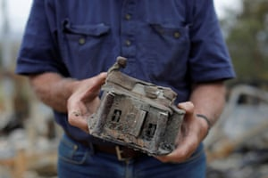 Buchan, Australia Farmer Jeff McCole displays a model house, made by his son Aaron, that remained after bushfire destroyed his family home in Victoria