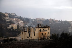 A house burns following a wildfire at Neos Voutzas, near Athens