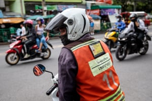 A driver waits for business at a motorbike taxi stand near where the brawl broke out