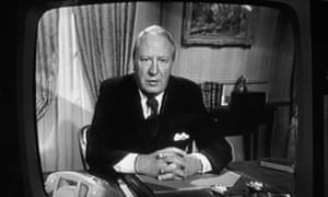 A black and white photo of a TV showing Ted Heath making a party political broadcast in 1974