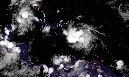 A picture made available by the National Oceanic and Atmospheric Administration shows Tropical Storm Marco, top left, and Laura, center, moving over the Caribbean and the Gulf of Mexico.