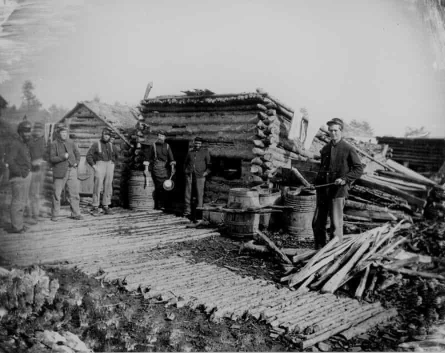 1861 photograph of a log kitchen.