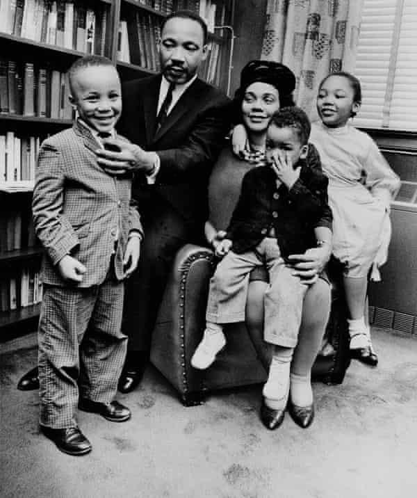 Coretta Scott King sits with her husband and three of their four children in their Atlanta, Ga, home in 1963.