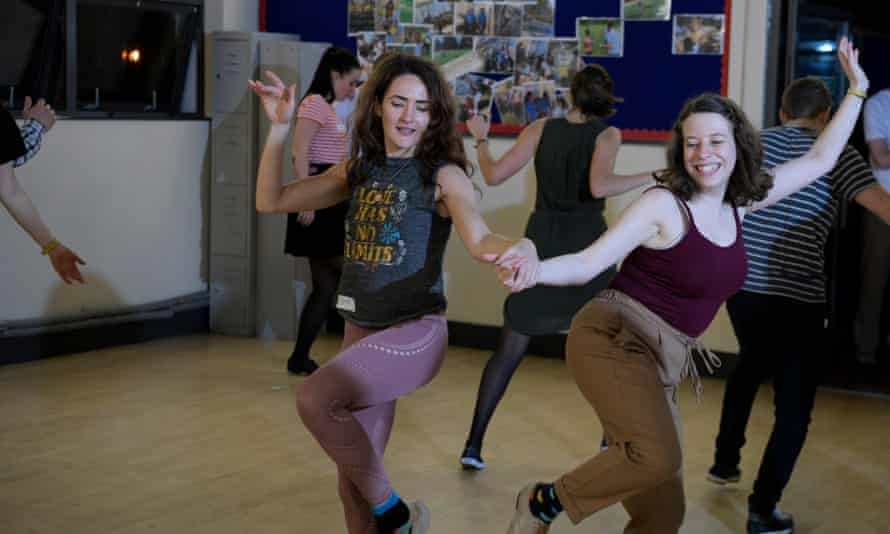 Sarah Marsh, left, learns swing dancing at the Swing Patrol Waterloo with teacher Cat Foley, right.