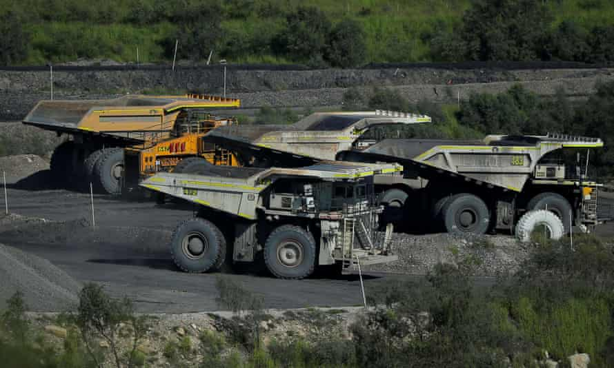 A coal truck passes others inside Rio Tinto's Hunter Valley operations in New South Wales.