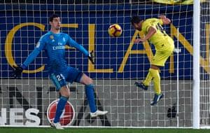 Santi Cazorla rises to head Villarreal's late equaliser past Thibaut Courtois.