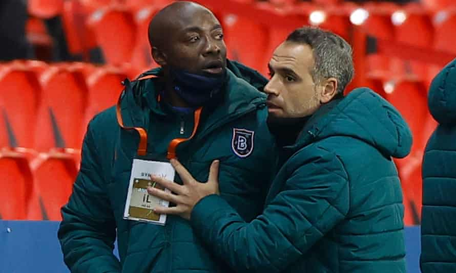 Pierre Webo, Basaksehir's assistant coach, is led away after being sent off.