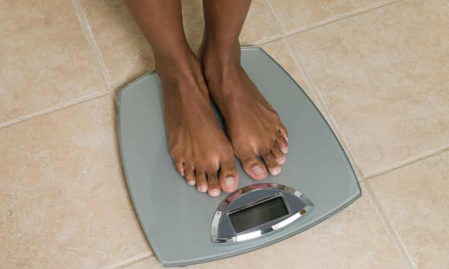 Feet of woman on scales.