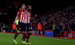 Cédric Soares celebrates with Nathan Redmond after doubling Southampton's lead.
