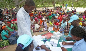 People in Funhalouro, in Mozambique's Inhambane province, receive food vouchers under a scheme funded by the UK's Department for International Development