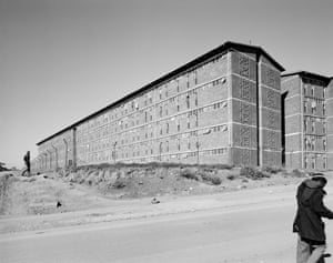 The south-east wing of a hostel for black male workers erected during apartheid as part of a scheme to make Joburg city and suburbs white. Alexandra Township, 1 June 1988. From the series Structures of Dominion and Democracy I (detail), 1988