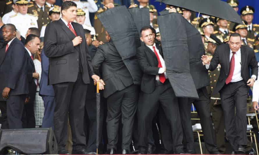 Security personnel surround Venezuela's president Nicolas Maduro