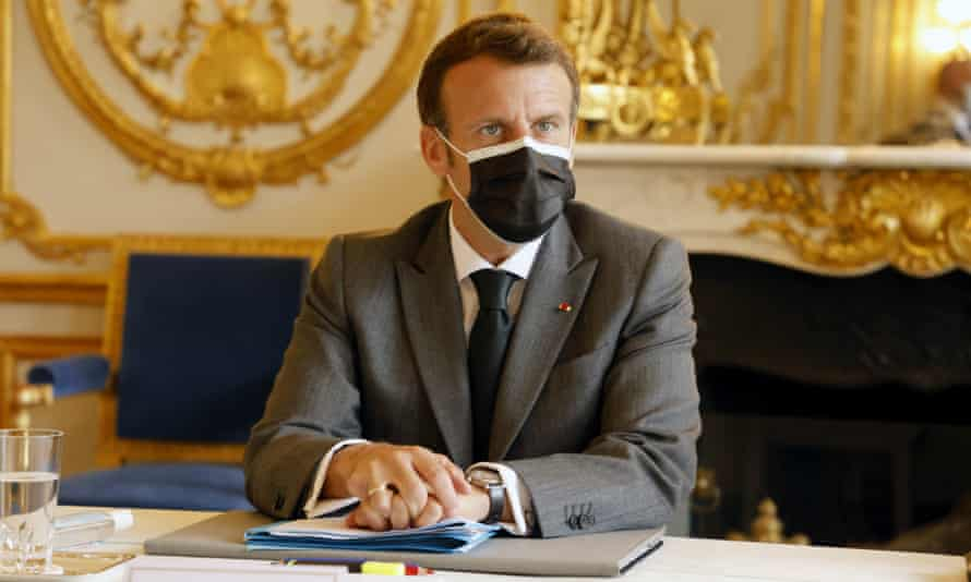 Emmanuel Macron looks on as he attends a meeting with nightclubs representatives the morning after the elections.