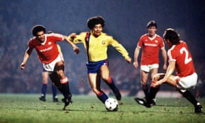 Maradona goes past Remi Moses (left) and Mike Duxbury at Old Trafford during the European Cup Winners' Cup, 1984