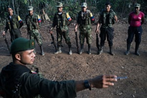 The mood is not entirely relaxed, as during morning formation, Andrés serving as the duty officer for this group, points out the route they will take if attacked by the army