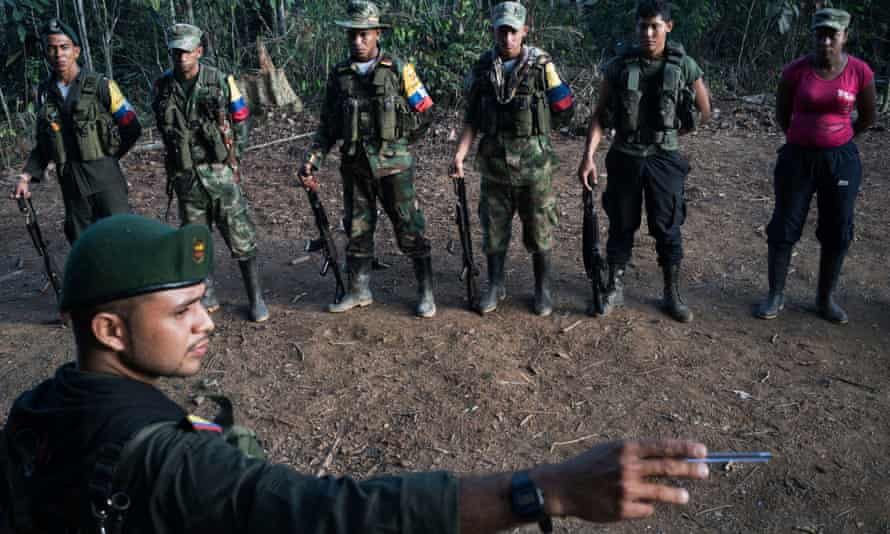 During morning formation, Alias Andrés serves as the duty officer for the group and points out the exact route the guerrillas will take if attacked by the army.