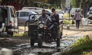 Men ride a motorcycle in Buenos Aires, Argentina.
