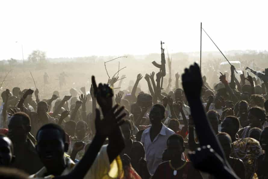 A soldier from Sudan's People's Liberation Army (SPLA) waves with his AK-47, Malakal, South Sudan