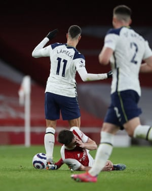 Kieran Tierney of Arsenal reacts after being fouled by Erik Lamela of Tottenham.