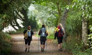 Walkers on the Camino de Santiago pilgrim's path to Santiago de Compostela in Galicia, Spain.