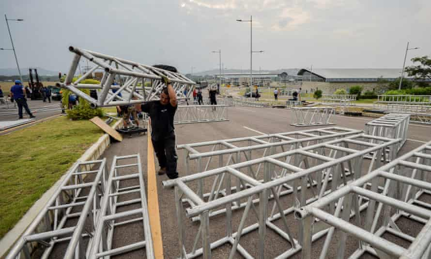 Workers assemble the platform for the concert organised by British billionaire Richard Branson.