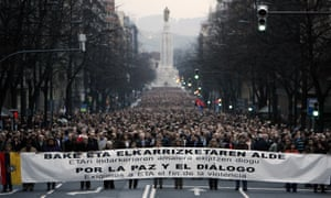 Anti-Eta protesters hold a banner that reads: 'For the peace and dialogue' as they walk through central Bilbao, in the Basque country, in January 2007.