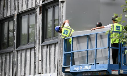 Workers removed cladding on tower blocks in Salford to check for combustibility.