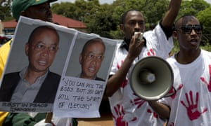 Members of the Rwanda National Congress mourn the opposition party's founder Patrick Karegeya in South Africa in 2014.