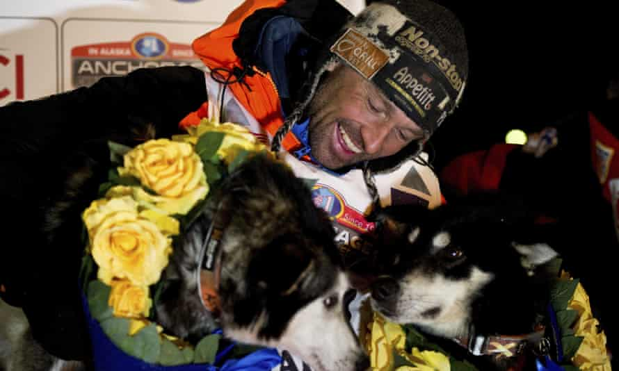 Thomas Waerner with two of his dogs after finishing this year's race in Nome, Alaska