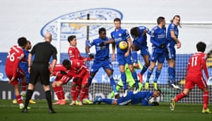 Leicester City players jump to block a free kick from Liverpool's Trent Alexander-Arnold.