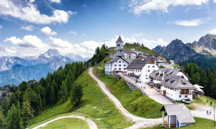 Village on hill with alpine backdrop