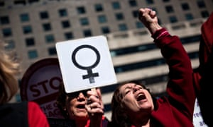 Activists protest in Washington DC against the Trump administration and rally for women's rights on International Women's Day, 8 March 2017
