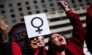 Activists protest against the Trump administration and rally for women's rights during a march to honor International Woman's Day on 8 March 2017 in Washington DC.