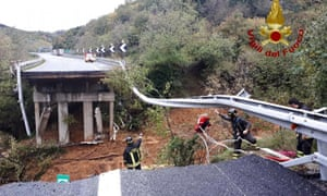 Firefighters at the scene after a stretch of the Turin to Savona A6 highway collapsed after heavy rains