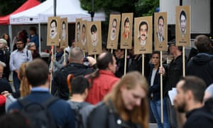 Activists hold banners with images of the NSU's victims outside the court in Munich, Germany.