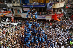 A human pyramid is formed to break a clay pot containing curd during a Hindu festival in Mumbai, India