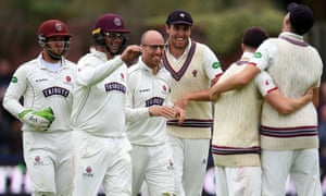 Jack Leach (third left) took five for 28 as Lancashire were out for 99 on the first day's play.