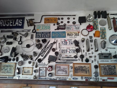 old registration plates, gears, hubcaps on the wall at Cafe Olimpo, Buenos Aires, Argentina