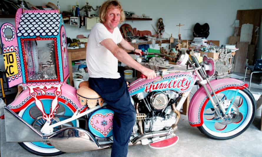 Grayson Perry tests out his bike Patience