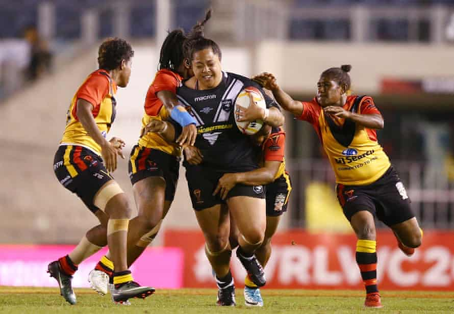 Annetta Nuuausala of the Kiwi Ferns takes on the Papua New Guinea Orchids in Rugby League World Cup.