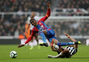 Crystal Palace's Wilfried Zaha is fouled by Newcastle United's Isaac Hayden as Palace win 1-0 after Luka Milivojevic scored from the penalty spot after ZAha was foulded by DeAndre Yedlin late on at at St James' Park.